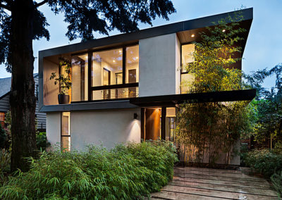 Modern home exterior lit at twilight
