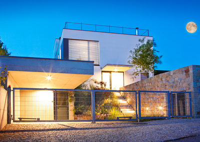 Modern family house exterior by twilight